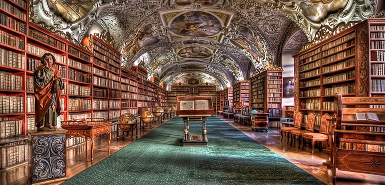 Beautiful historic library with a painted, domed ceiling.