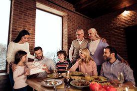 Three generations of family celebrating