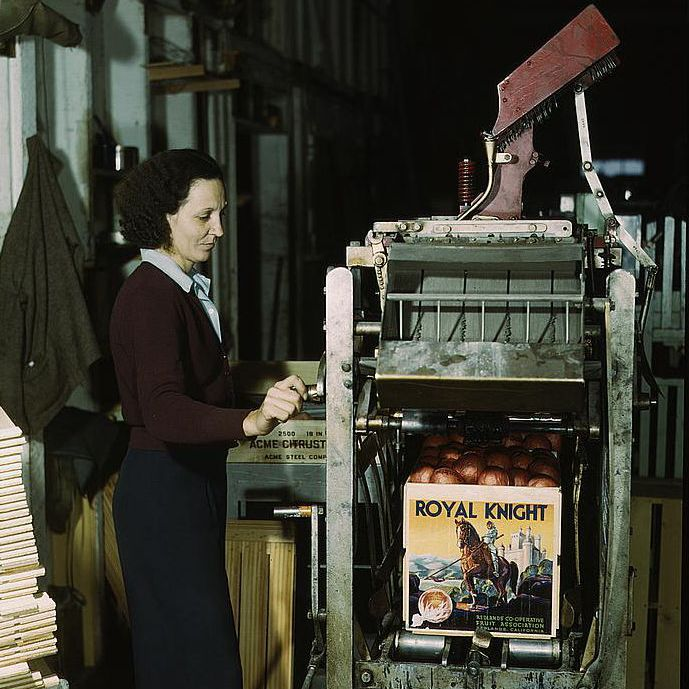 Woman operating a machine at an orange packing plant, March, 1943
