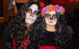 Two people in scary costumes
