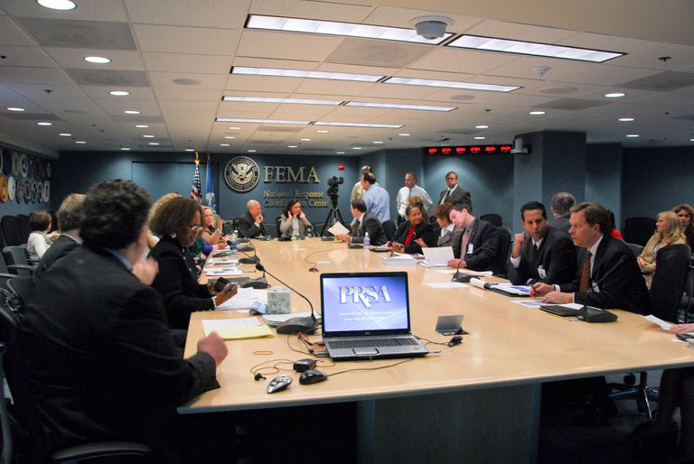 PR professionals around a conference table at FEMA headquarters.