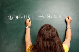 Woman writing chemical equations