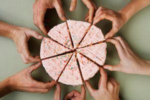 Hands grabbing pieces of cake