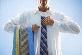 Businessman Selecting Tie