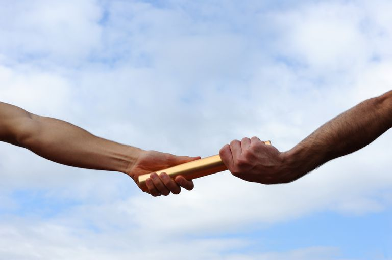 hands passing a baton