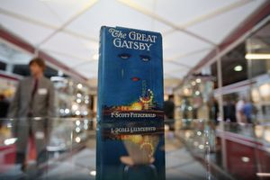 A copy of The Great Gatsby on a mirrored display