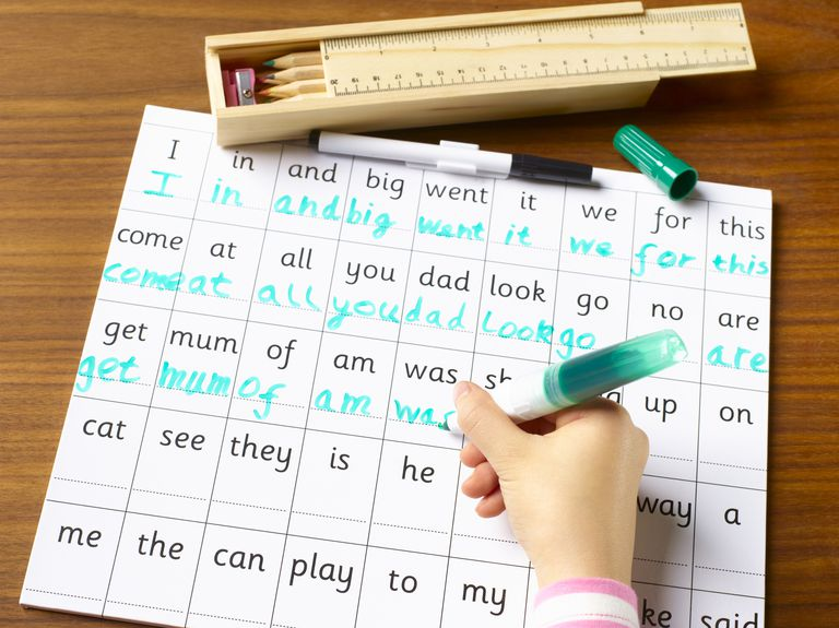 Child practicing handwriting and spelling