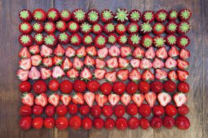 Strawberries arranged in patterned rows