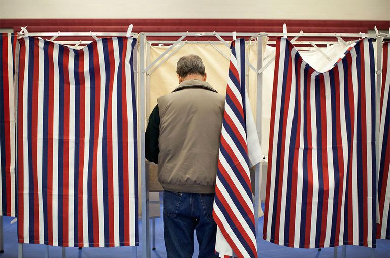A man votes in the New Hampshire primary