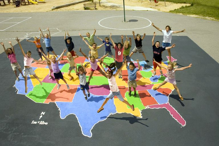 Children leaping on a colorful asphalt map of the U.S.