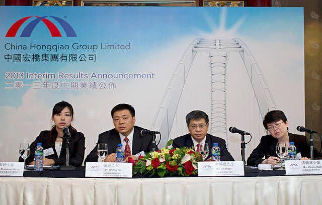 Executives of China Hongqiao Group, Ltd. attend the company's earnings news conference in Hong Kong, China