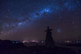 Panoramic view with Pachamama monumet and milkyway on Isla del Sol , Titicaca Lake