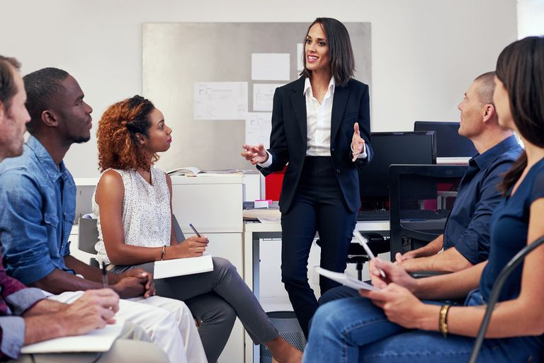 Manager leading a meeting in office