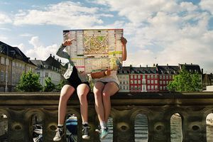Picture of two teenagers reading a city map in Copenhagen.