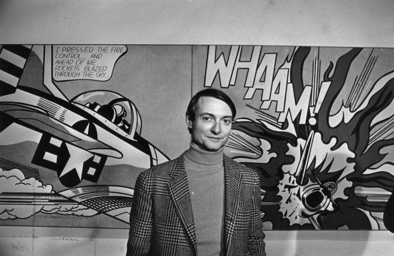 Roy Lichtenstein pictured in front of his painting, Whaam!