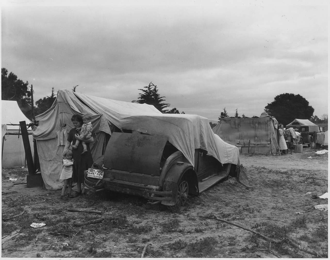 Migrant family near their temporary home during the Great Depression