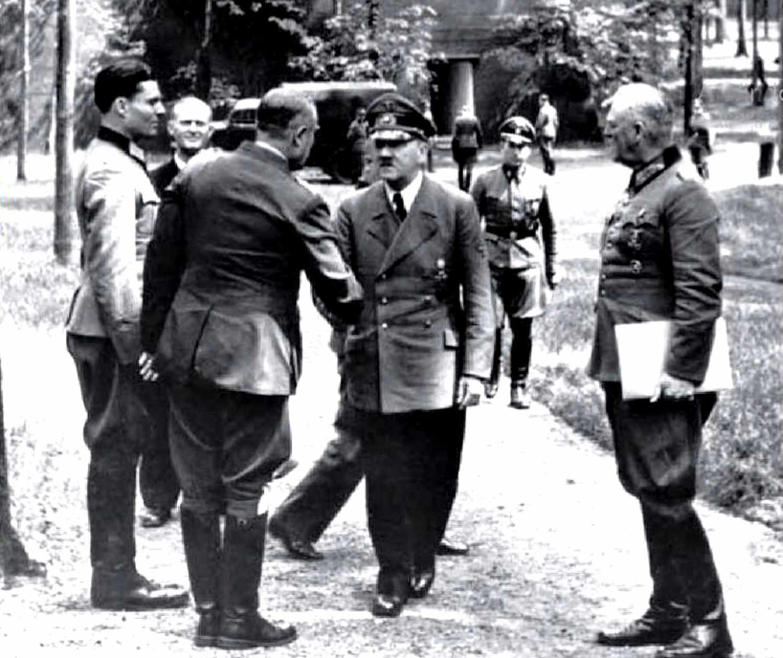 Claus von Stauffenberg, left, with Hitler (centre) and Wilhelm Keitel, right, in an aborted assassination attempt at Rastenburg on 15 July 1944.