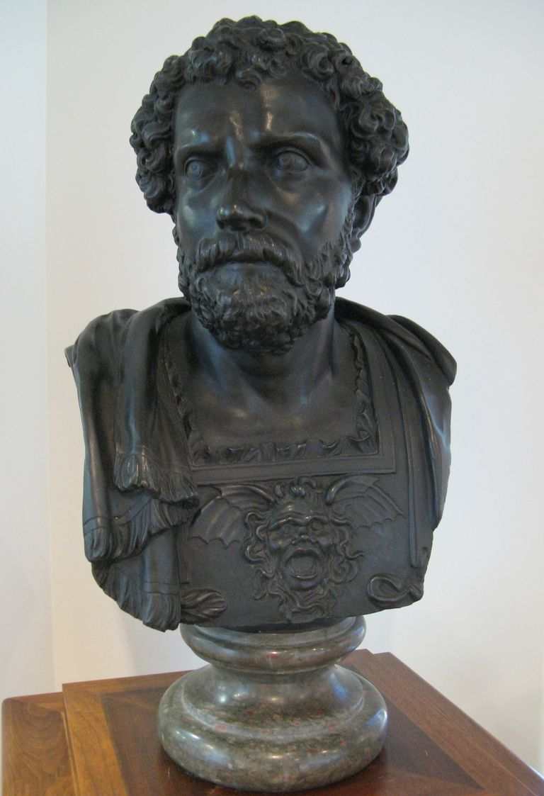 Bust of Hannibal Barca on shelf.
