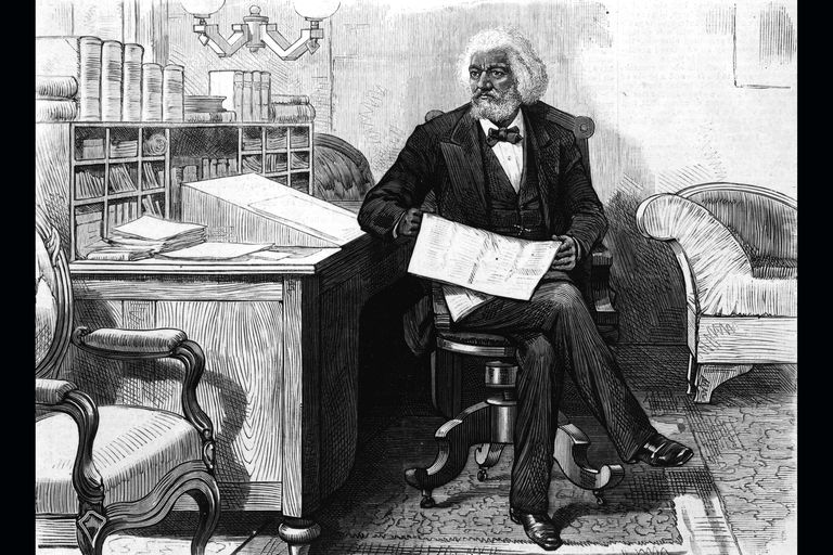 Frederick Douglass editing newspaper at his desk, 1870s