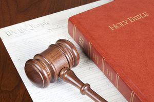 Gavel on top of a bible and copy of the constitution.