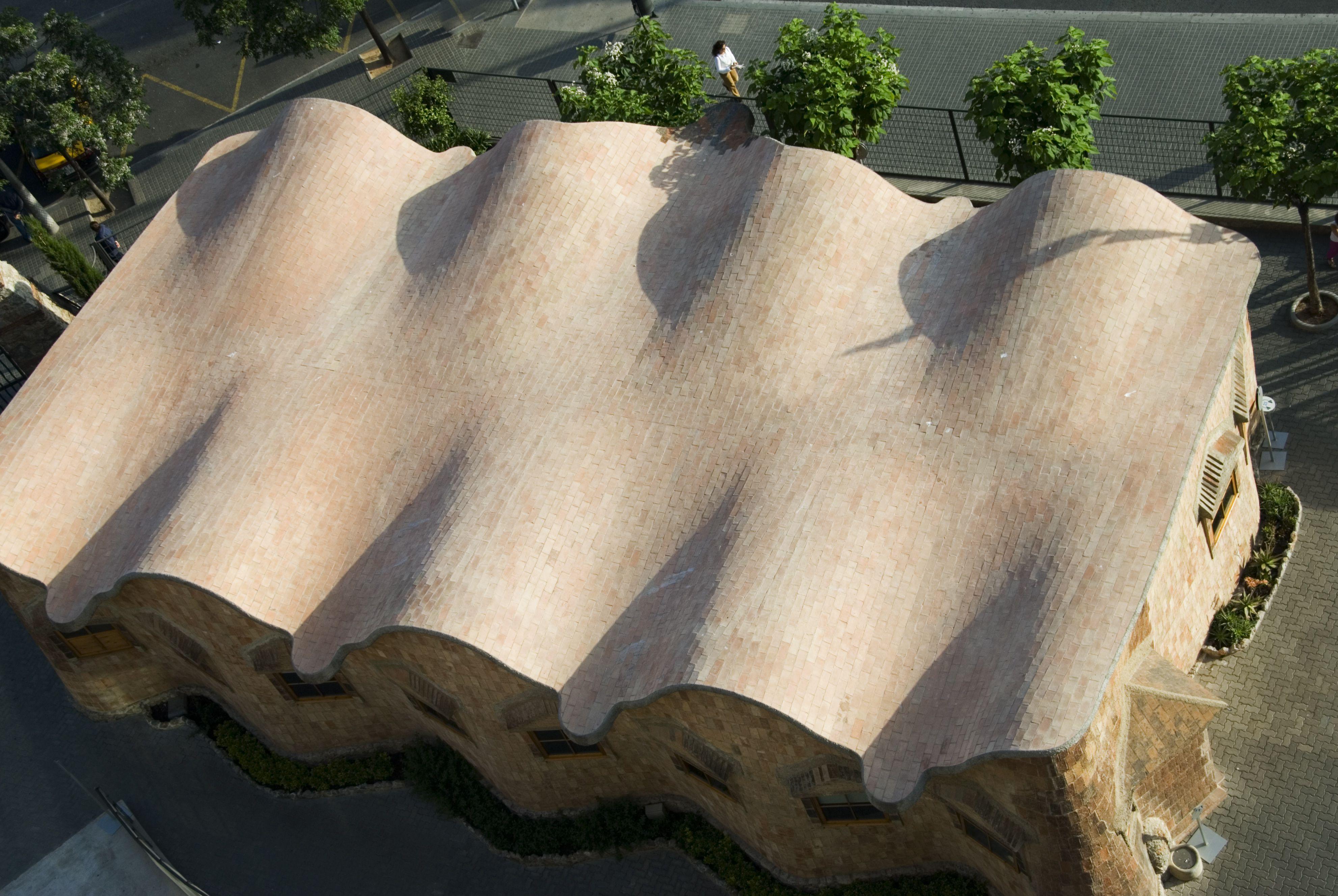 Undulating roof of Sagrada Familia School by Antoni Gaudí in Barcelona, Spain