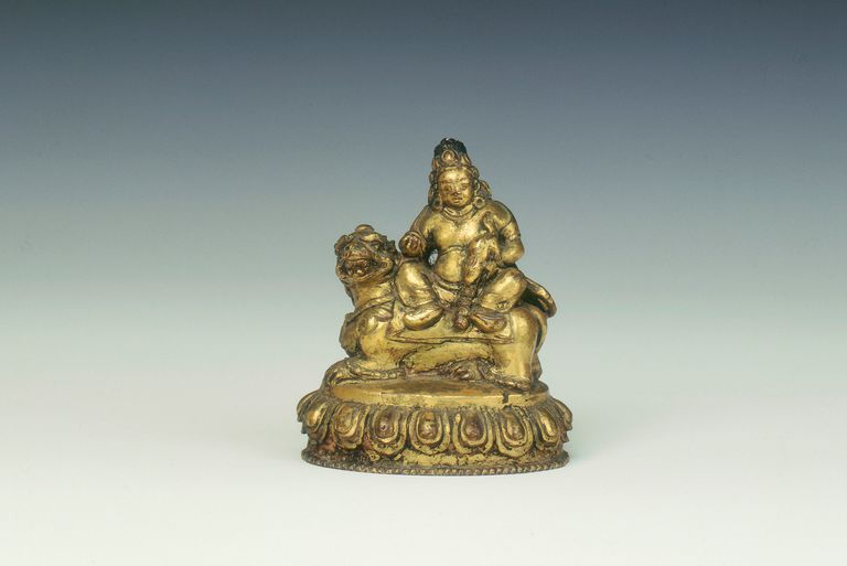 Gilt-copper figure of Kubera, Tibet, 18th century.