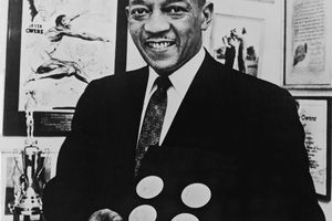 Jesse Owens Poses With Gold Medals