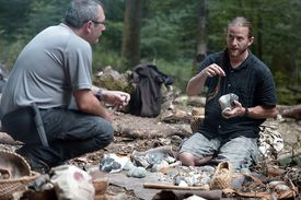 two archaeologists talking at a dig site
