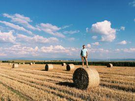 Man standing on haystack