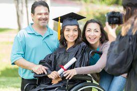 Proud parents with college graduate