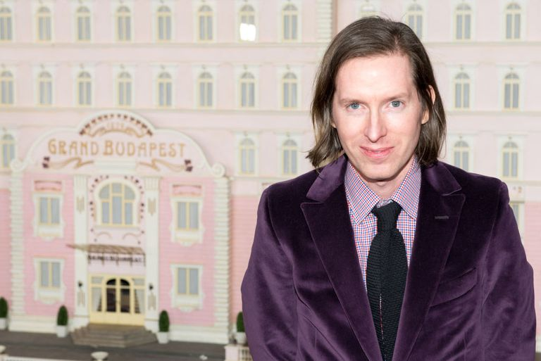 Wes Anderson in front of Budapest Hotel