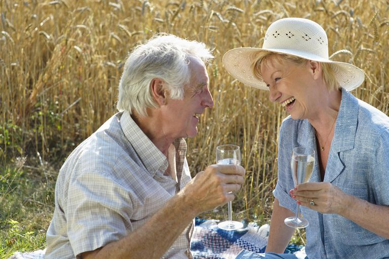 Senior couple in countryside drinking wine
