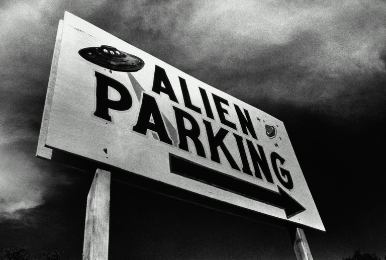 Sign pointing to an alien parking lot in Roswell, New Mexico