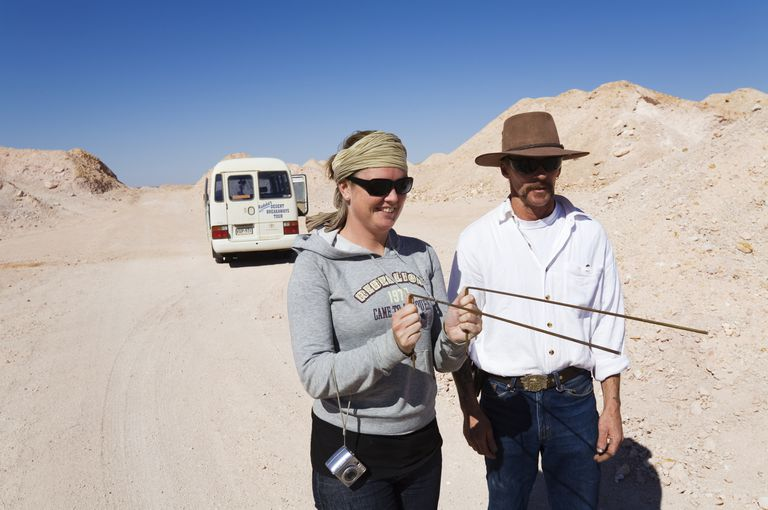 Tourists Using Dowsing Rods