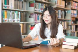 Smart young woman satisfied with learning language during online courses using netbook,