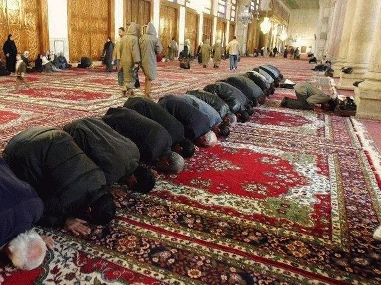 Muslims in prostrate prayer towards Mecca; Umayyad Mosque, Damascus.