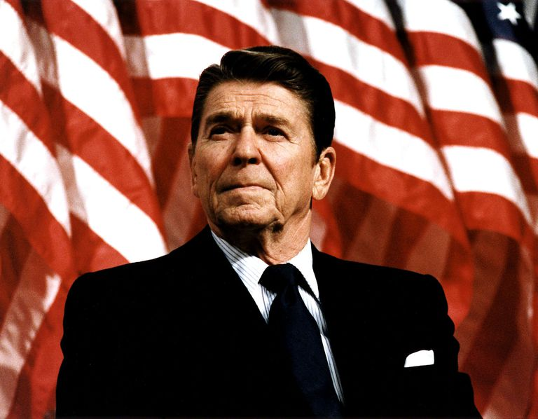 Ronald Reagan in front of American flags