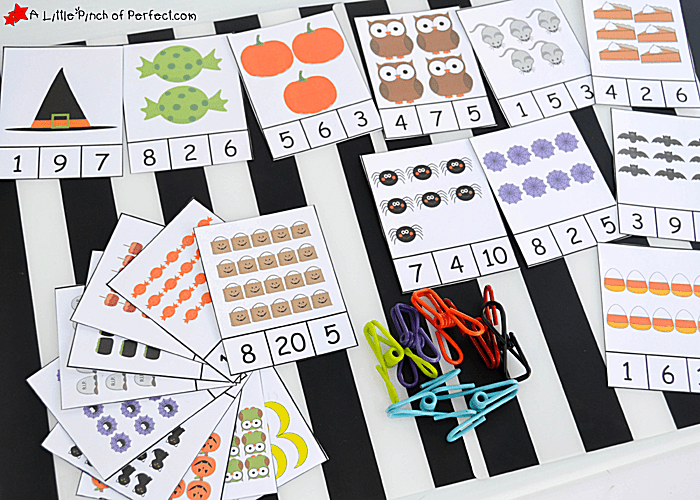 Halloween math clip cards laying on a table.