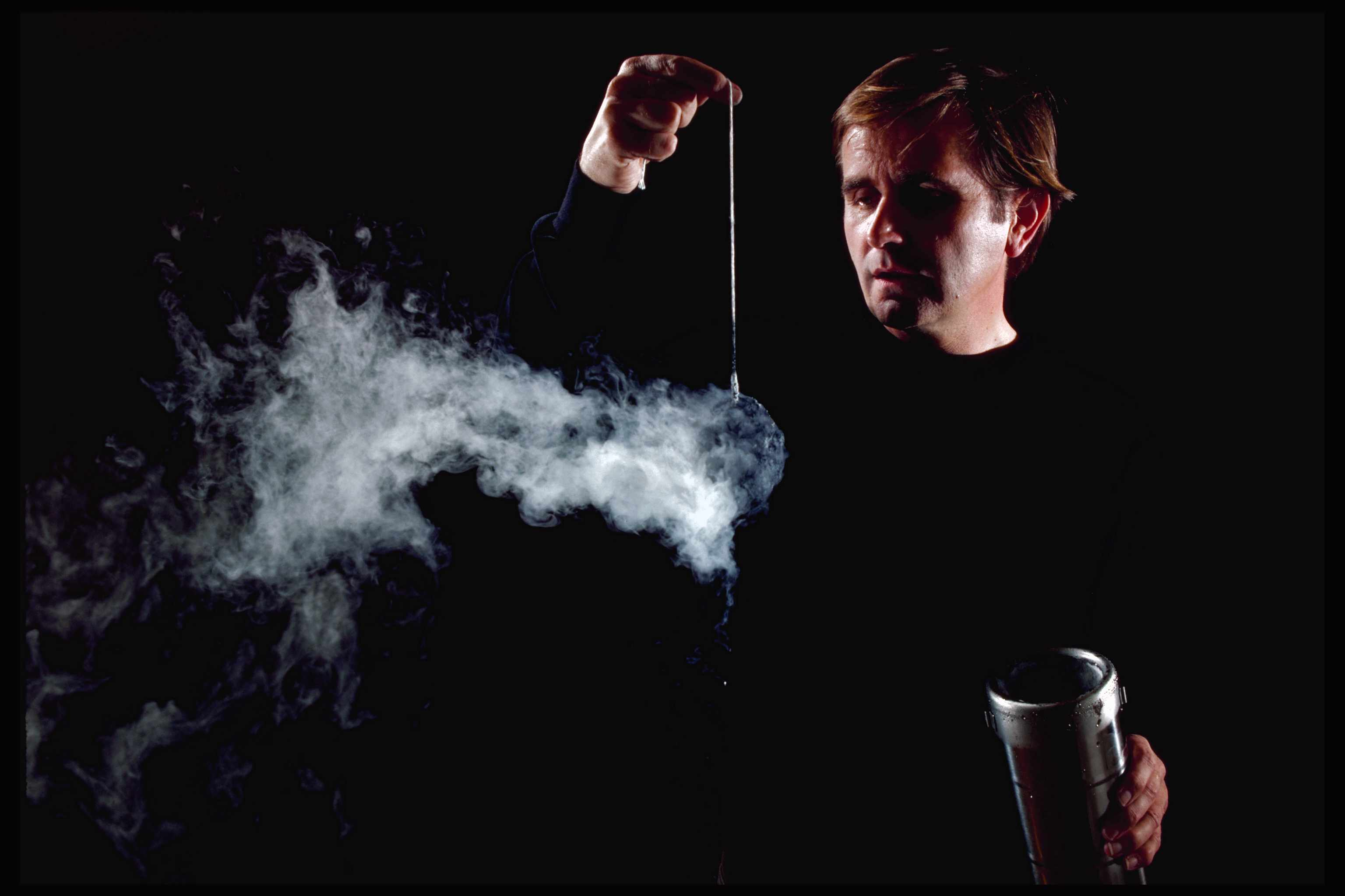 Man swinging a comet model of charcoal and ice