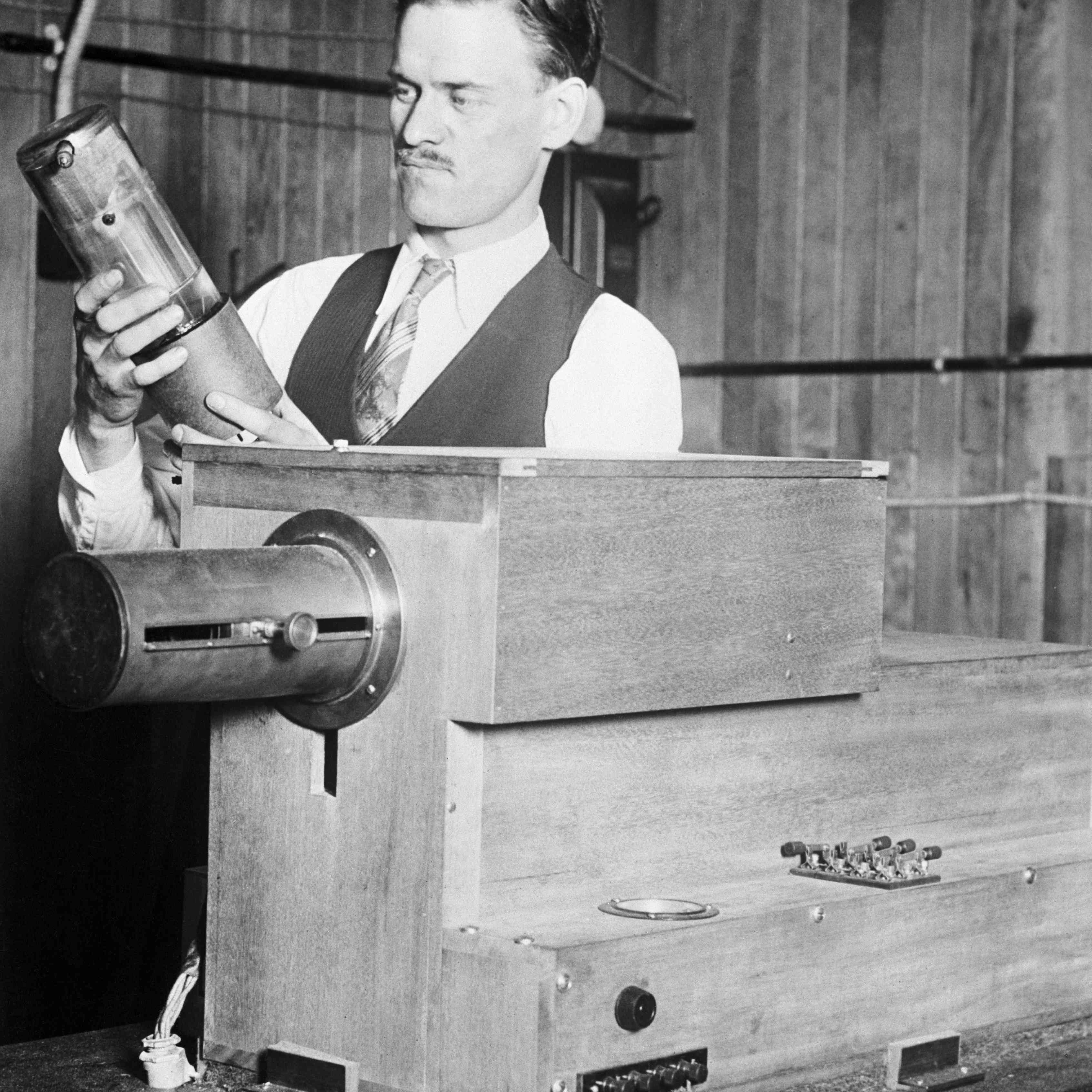 Photograph of Philo Farnsworth with his early television components