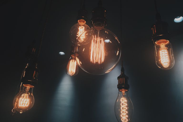 Light bulbs hanging down in a dark room.