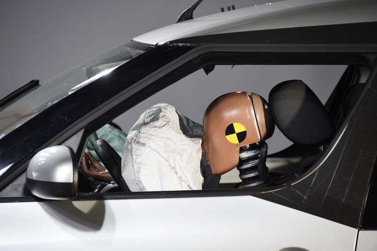 A crash test dummy impacting an airbag