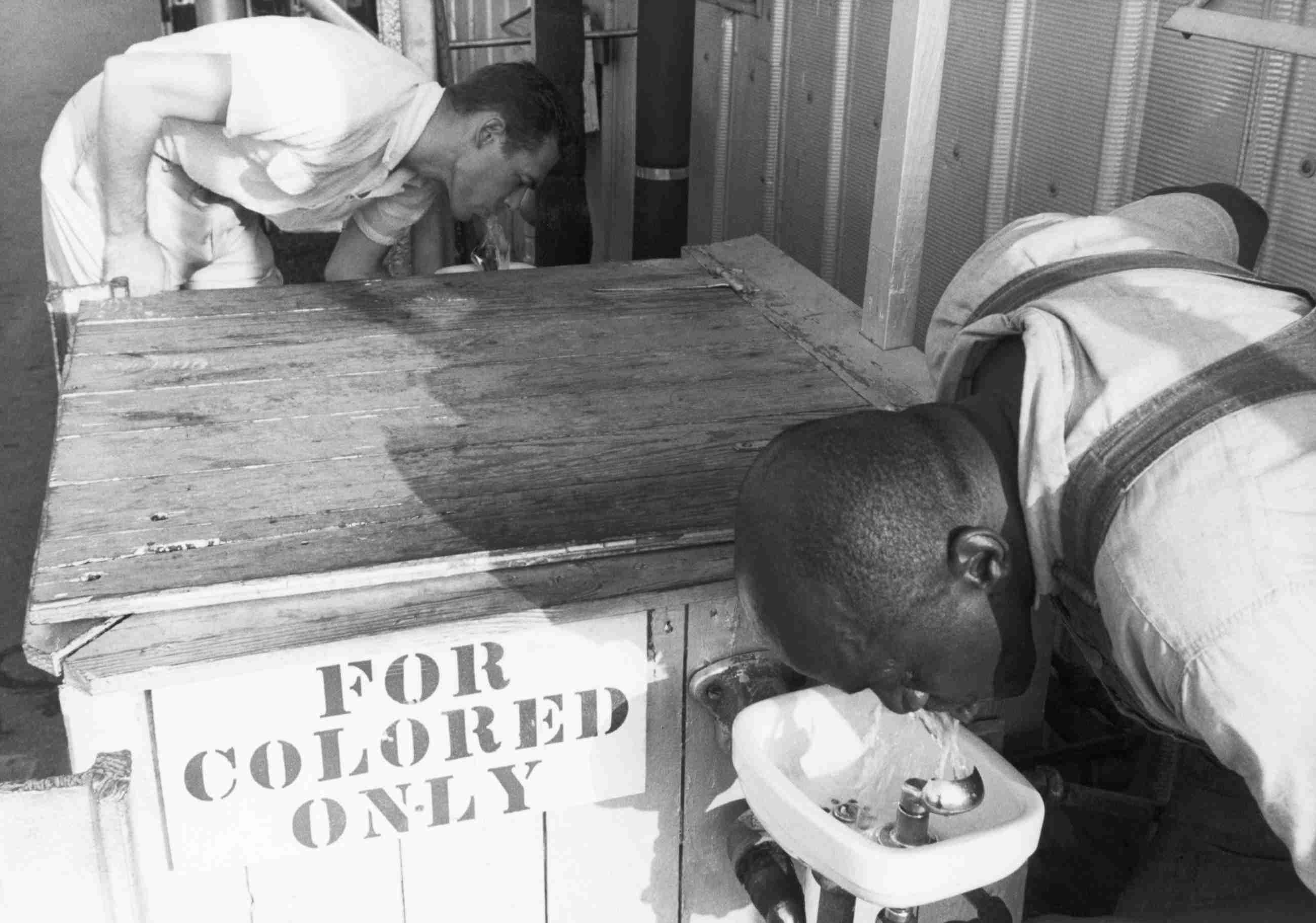 Men Drinking from Segregated Water Fountains