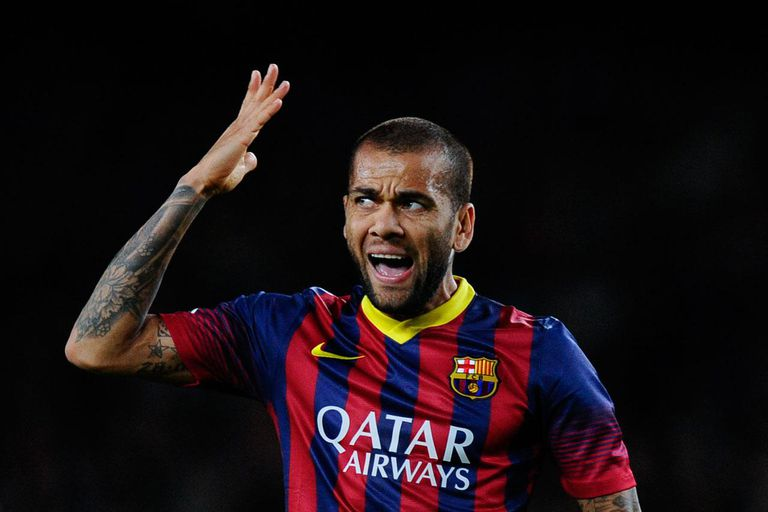 BARCELONA, SPAIN - NOVEMBER 01: Dani Alves of FC Barcelona reacts after missing a chance to score during the La Liga match between FC Barcelona and RCD Espanyol at Camp Nou on November 1, 2013 in Barcelona, Spain.