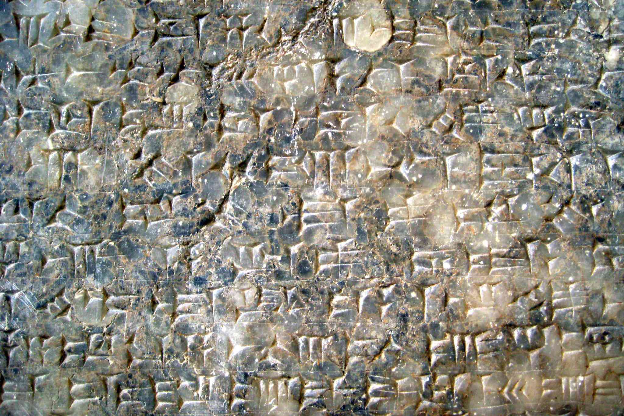 Cuneiform, one of the first forms of writing, covers a stone tablet