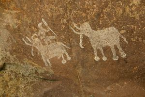 mesolithic artwork depicting elephants and a rider