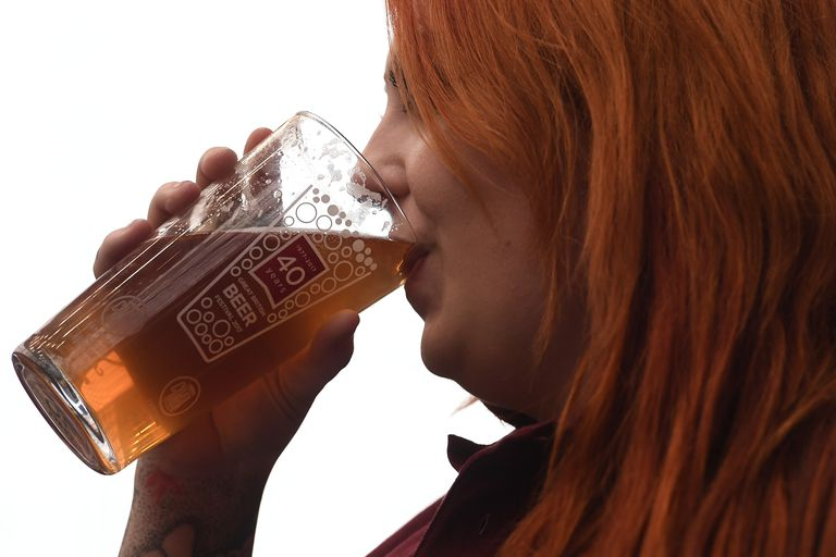 Woman drinking a glass of beer