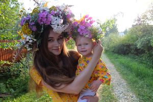 Portrait Of Young Woman With Baby Girl Wearing Flowers On Hair At Field - stock photo Photo Taken In Yegor'yevsk, Russia
