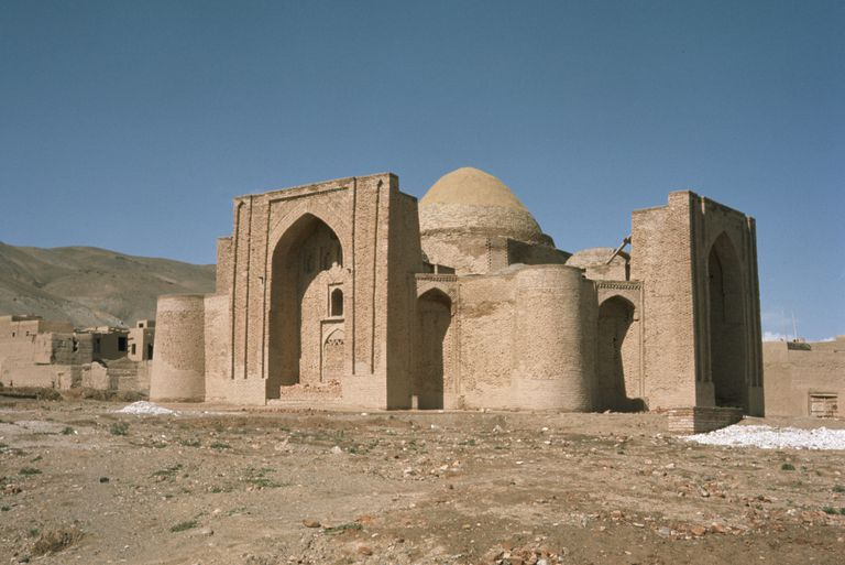 Mausoleum of Mahmud of Ghazni against blue sky.