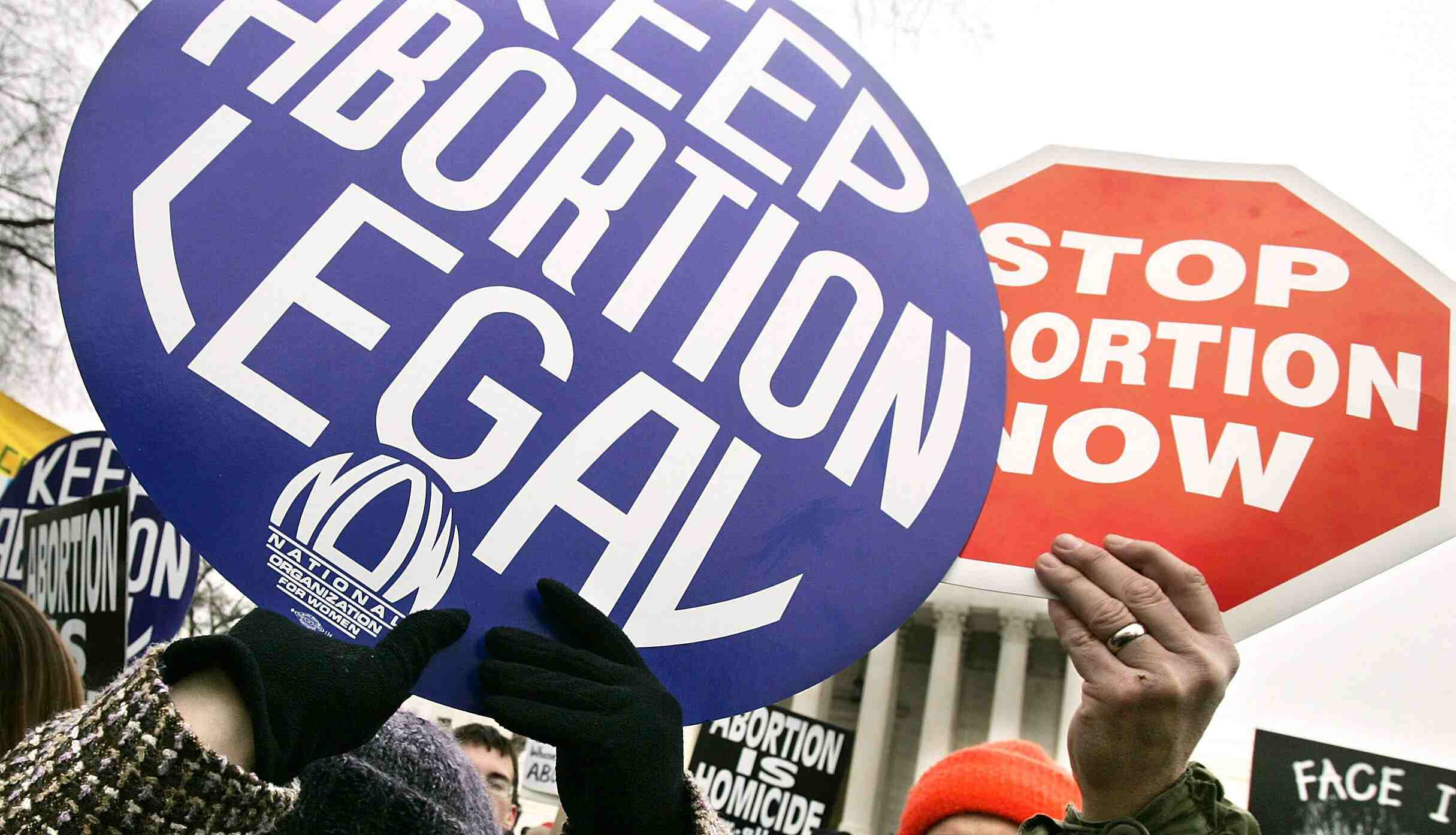 Pro-choice and pro-life signs at 2005 march in Washington, DC.